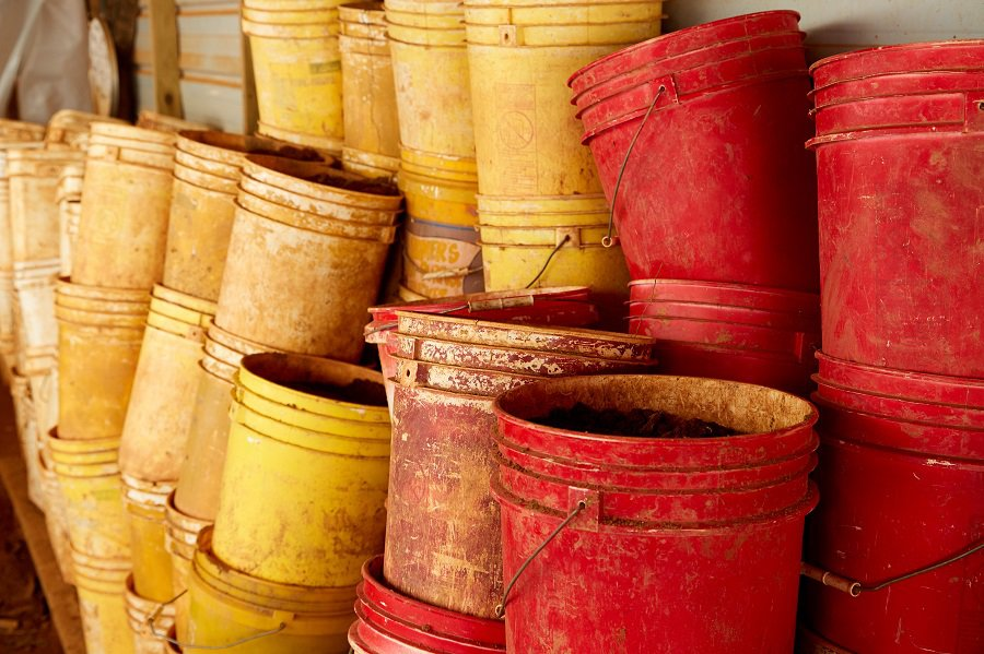 Stacks of Red and Yellow Buckets